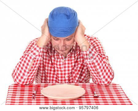 Hungry man is looking in his empty plate