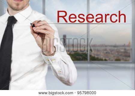 Businessman Writing Research In The Air