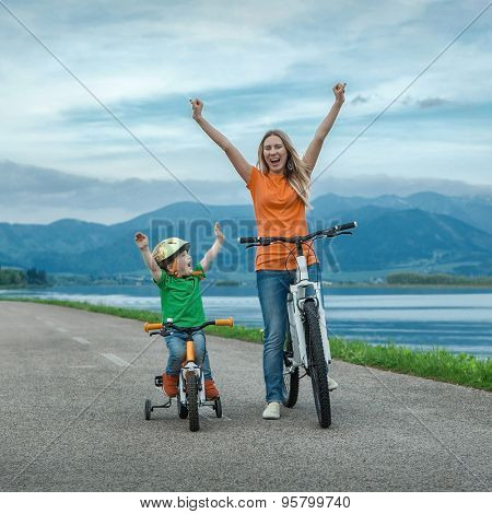 Happiness Mother and son on the bicycles funning outdoor