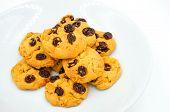 pic of baked raisin cookies  - Raisin and cornflake cookies on white background - JPG