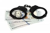 stock photo of handcuff  - Handcuffs on money isolated on white business security concept - JPG