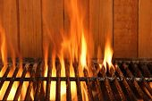 foto of braai  - Flaming BBQ Charcoal Cast Iron Grill Close - JPG