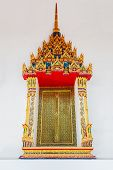 stock photo of buddhist  - Beautiful window with Thai culture art decoration on the Buddhist church wall - JPG