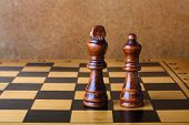 pic of chessboard  - One chess king dominating another on the chessboard - JPG