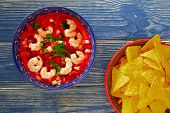 foto of nachos  - Ceviche de Camaron shrimp and mexican nachos plate on blue wood table - JPG