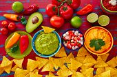 stock photo of nachos  - Mexican food nachos guacamole pico de gallo and dipping cheddar cheese - JPG