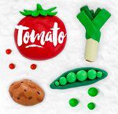 image of leek  - Plasticine modeling vegetables tomato peas leek potato cobbled together on a white plasticine background - JPG