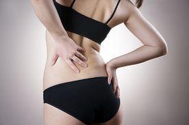 stock photo of sick kidney  - Woman with backache - JPG