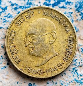 picture of gandhi  - An antique Indian coin or currency showing Mahatma Gandhi lifespan 1869 - JPG
