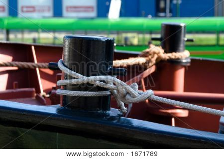 Metal Capstans And Ropes