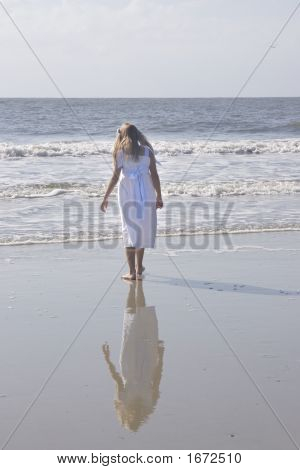 Girl In A White Dress At The Beach