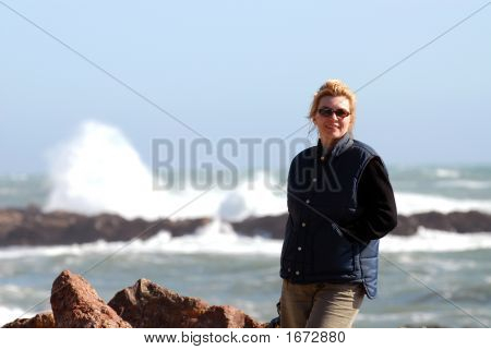 Woman Standing By Sea
