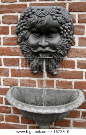 Drinking Water Gushes From A Gargoyle Mouth.