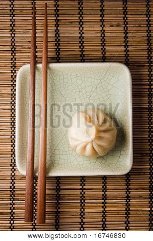 Dumpling and chopsticks