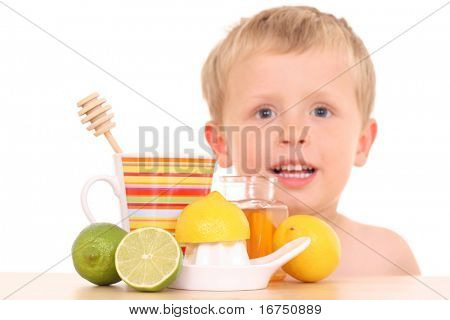 3-4 years old boy with cold and flu remedy on white /focus on remedy/