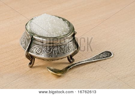Very old silver saltcellar with spoon
