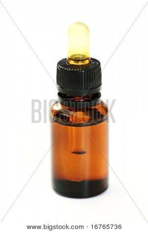 bottle of essential oil isolated on white