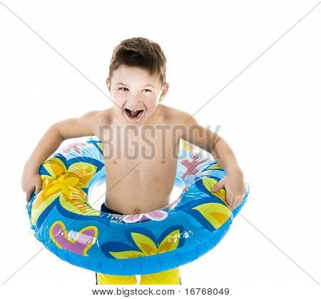 Little boy standing with a float