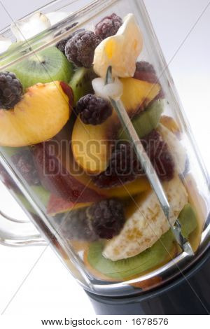 Fresh Fruits In A Glass Blender White Background