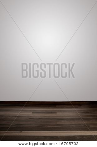 Empty white wall and wooden floor with a spot light in the wall