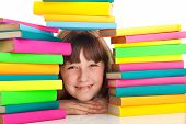 Girl Sitting Behind Pile Of Books