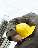 picture of hard_hat  - focus point on the hard-hat and hand special photo toned f/x ** Note: Shallow depth of field - JPG