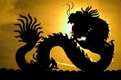Chinese Dragon. - A Silhouette Image Of Chinese Dragon Statue In Dragon Chinese Temple. Sun Dragon P poster