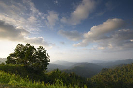 image of landscapes beautiful  - landscape of mountains disappearing into the distance in the late afternoon light - JPG