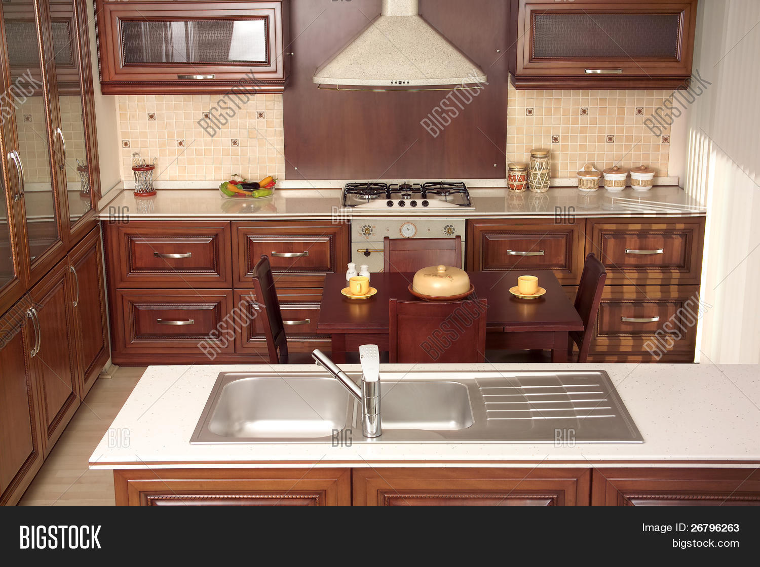 Modern Kitchen With Cherry Drawers And Granite Countertops