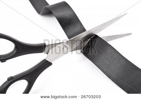 Scissors cutting black ribbon