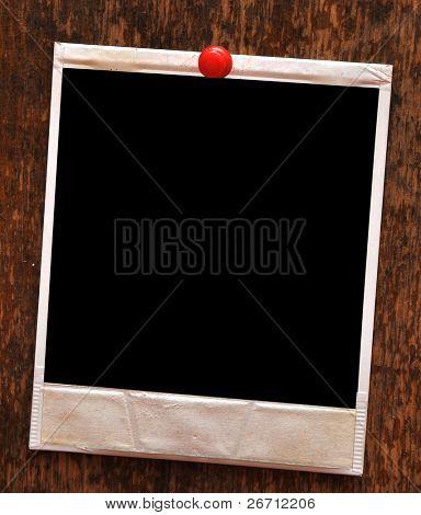 single blank photo frame on wooden background