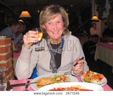Woman Making A Toast In A Restaurant.