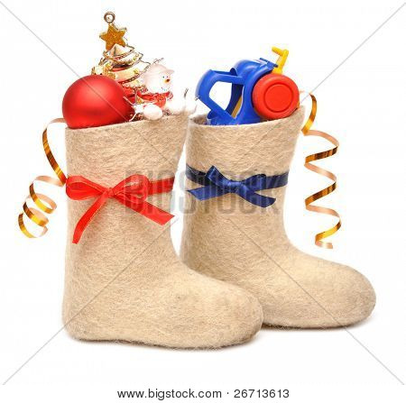 children's boots with gifts. Blue ribbon for boys, red ribbon for girls