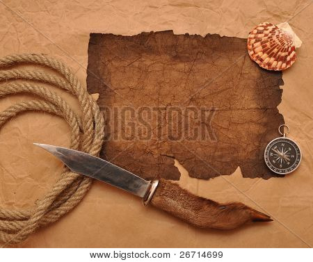 old paper, rope, compass, decorative knife on old paper