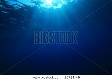 Sun rays in blue water