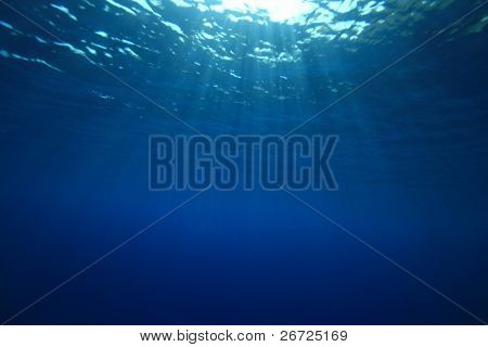 Abstract background of sun rays on the ocean surface