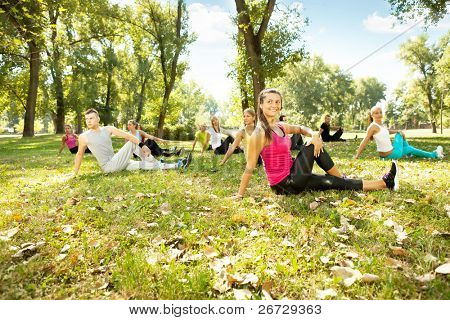 fitness class exercising in park