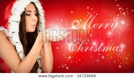 """sexy santa girl blowing magical """"Merry Christmas"""" text"""