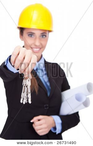 smiling young architect shoving  keys  of new house, isolated on white background