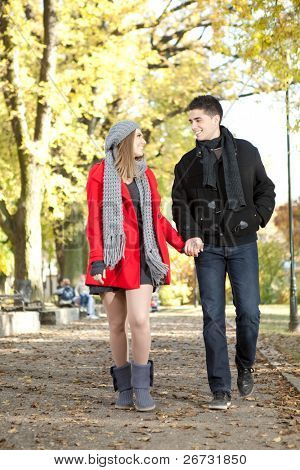young love couple walking in romantic autumn park