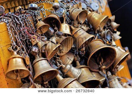 Many metal sacrificial bells hanging on chain, Kathmandu, Nepal