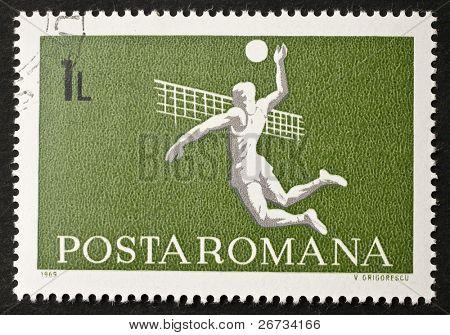ROMANIA - CIRCA 1969: a stamp printed in Romania shows image of a volleyball slam over the net. Romania, circa 1969