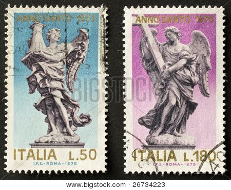ITALY - CIRCA 1975: two stamps printed in Italy celebrates Jubilee showing marble angel statues. Italy, circa 1975