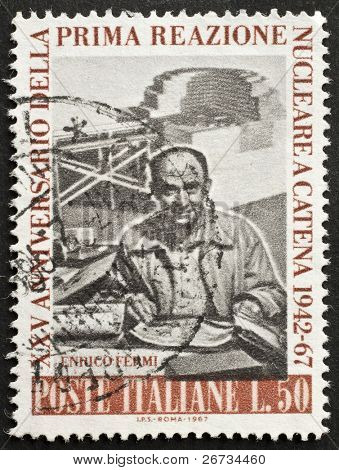 ITALY - CIRCA 1967: a stamp printed in Italy celebrates 25th anniversary  of the first nuclear chain reaction, showing an image of Enrico Fermi, the famous italian nuclear scientist. Italy, circa 1967