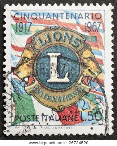 ITALY - CIRCA 1967: a stamp printed in Italy celebrates fiftieth anniversary of Lions Club International, the famous secular service organization. Italy, circa 1967