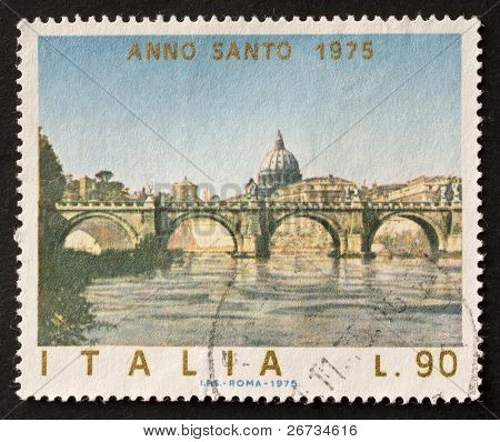 ITALY - CIRCA 1975: a stamp printed in Italy celebrates Jubilee showing a bridge upon Tevere river in Rome and St. Peter's dome in background. Italy, circa 1975