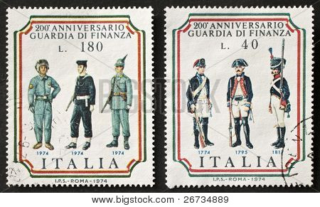 ITALY - CIRCA 1974: two stamps printed in Italy celebrates second centenary of Guardia di Finanza, the italian police force under the authority of Minister of Economy and Finance. Italy, circa 1974