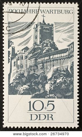 EAST GERMANY (DDR) - CIRCA 1966: a stamp printed in East Germany celebrates the ninth centenarian of the Wartburg Castle. East Germany, circa 1966