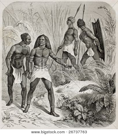 Old illustration of native Africans near Kidi, southern Sudan. Created by Castelli, published on Le Tour du Monde, Paris, 1864