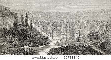 Old illustration of aqueduct over Meles river, near Smyrne (present days Izmir), Turkey. Created by Gaiaud, published on Le Tour du Monde, Paris, 1864